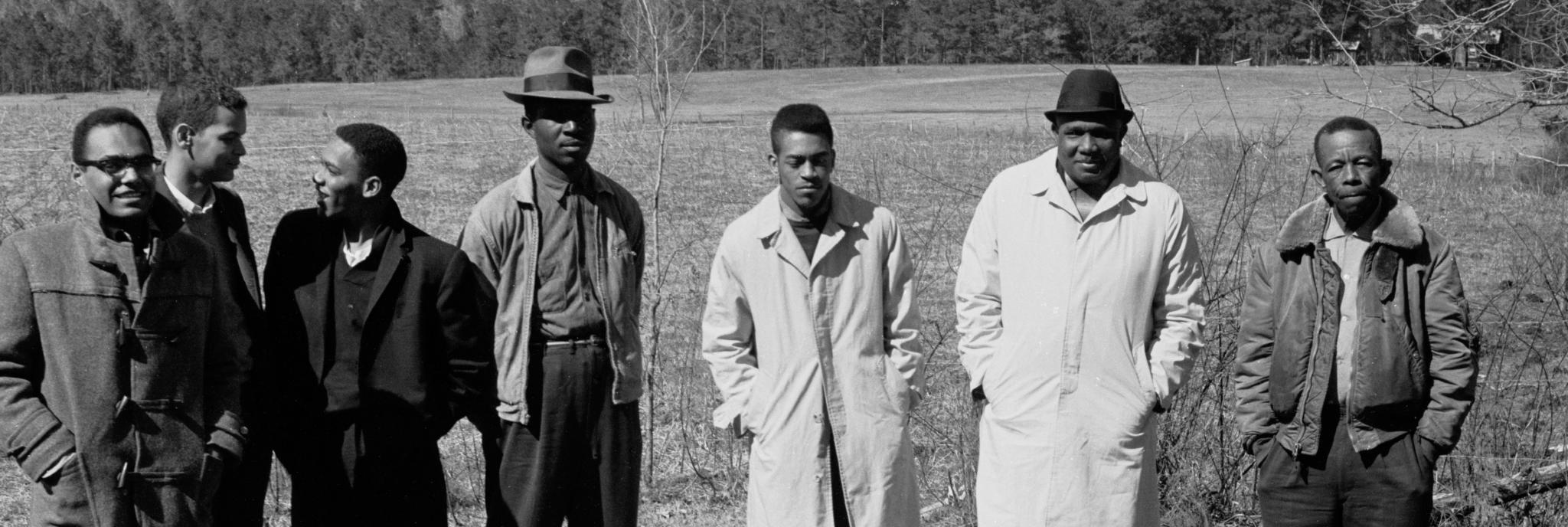 1963, Mississippi Voter Registration Activists (L to R) Bob Moses, Julian Bond, Curtis Hays, unknown activist, Hollis Watkins, Amzie Moore,  and E.W. Steptoe