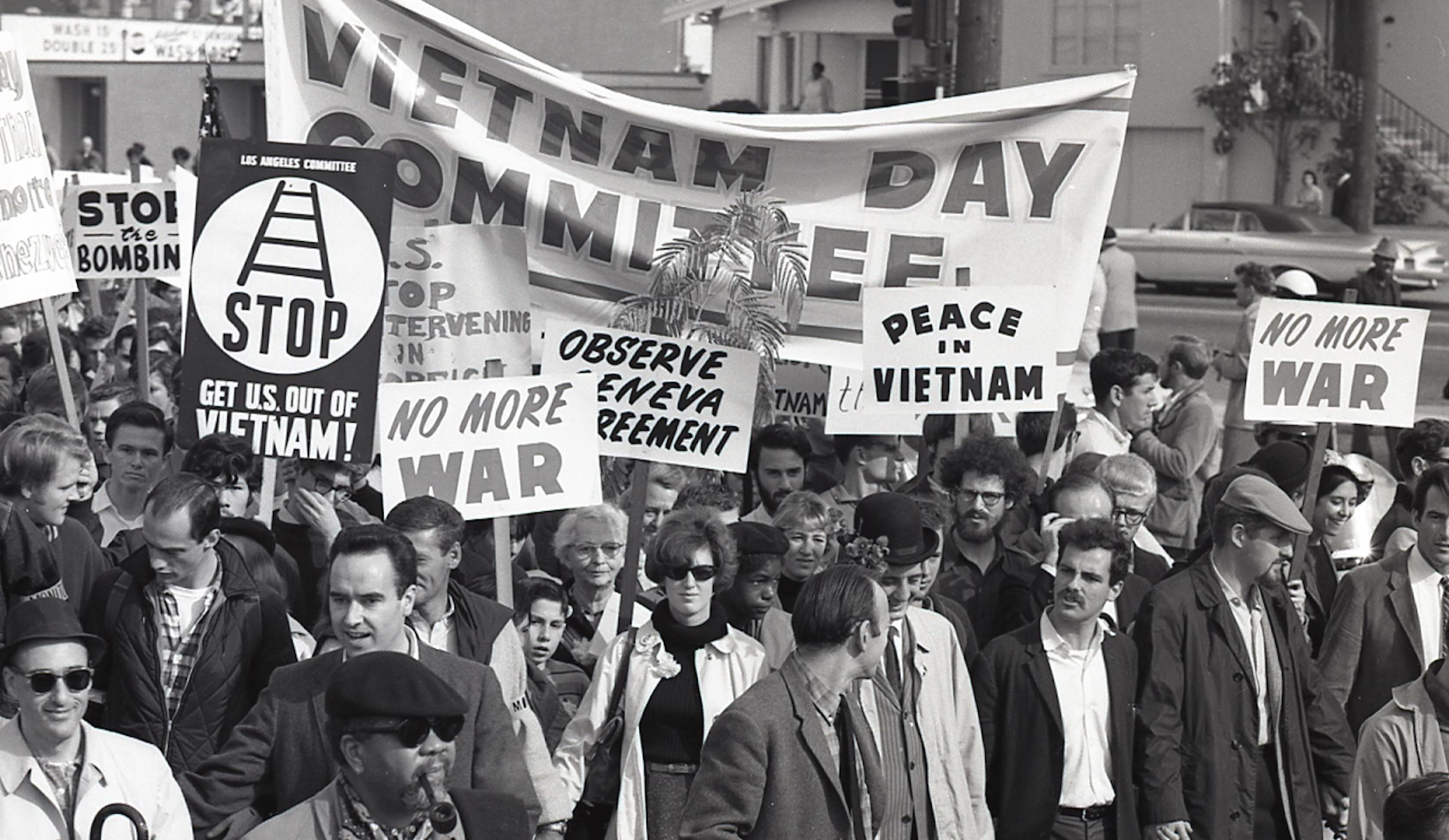 November 20, 1965, Vietnam Day Committe marches with Congressman John Burton, Jerry Rubin, Vietnam Veteran David Douglas Duncan, among other notables in the front. Francis Tandy (white haired elder of the peace movement) is visible under the banner.