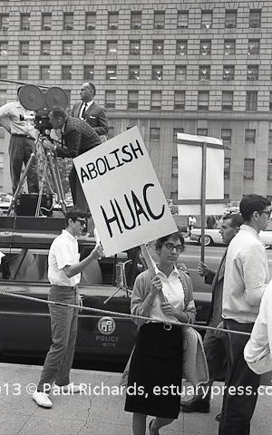 1962, Los Angeles, CA, demonstration to Abolish HUAC. Police car and camera crew photographing participants in the protest march.