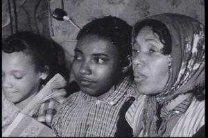"""Civil Rights Activist Herbert Lee's widow and two of their children from a screen shot take from the 1963 film """"We'll Never Turn Back"""" by Harvey Richards"""