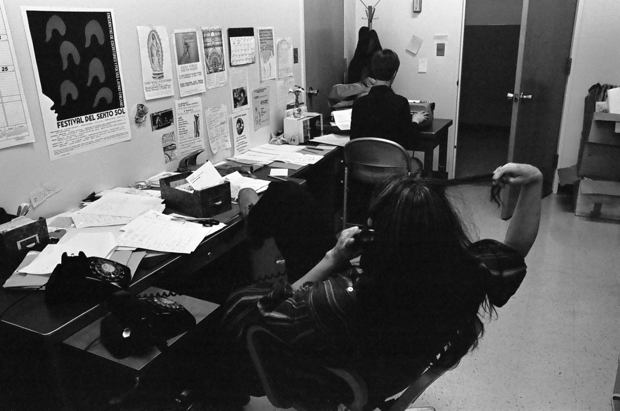 Nina at desk 1970s photo 1 scaled
