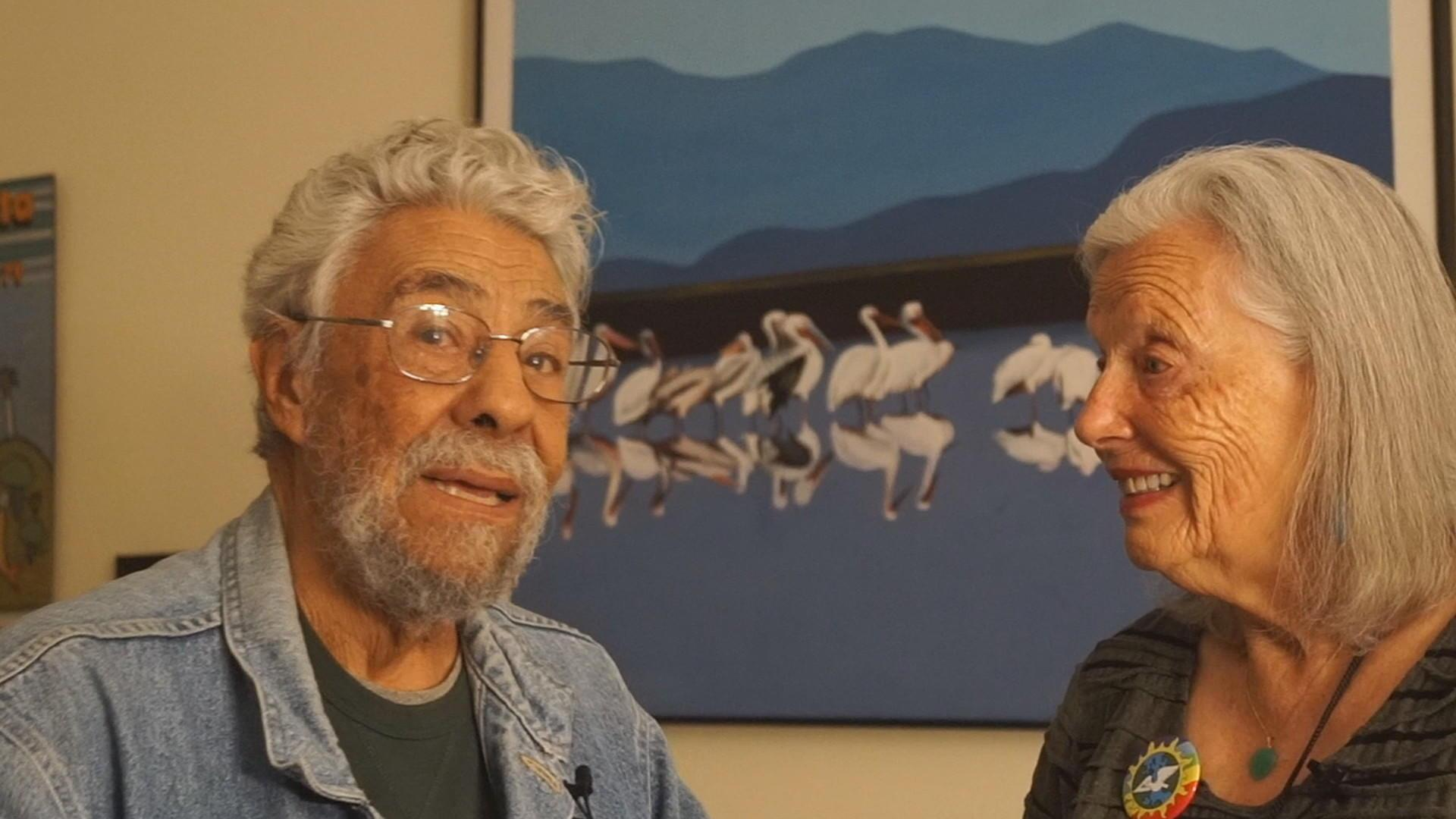 Nina Serrano interviewing Rafael Jesús González about the Universal Earth Justice Peace flag and button